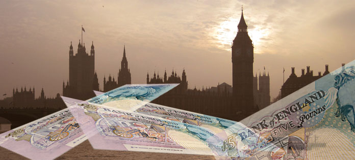 Public sector pay, image of money and the Palace of Westminster. Image John New